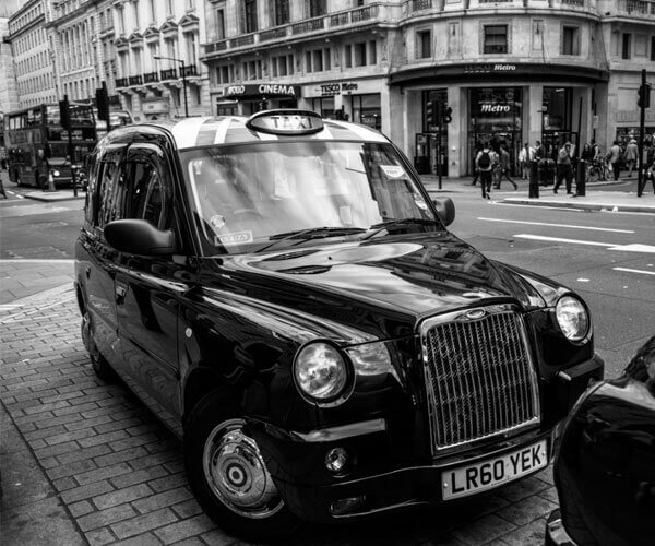 Black and white taxi manchester
