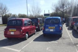 Blue and Red Manchester taxi